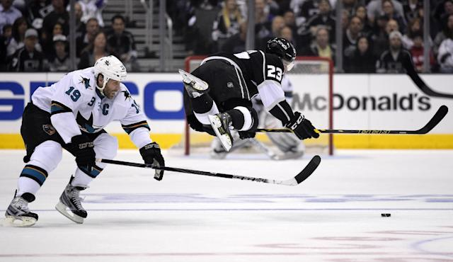Los Angeles Kings right wing Dustin Brown, right, is tripped by San Jose Sharks center Joe Thornton during the first period in Game 6 of an NHL hockey first-round playoff series, Monday, April 28, 2014, in Los Angeles. (AP Photo)