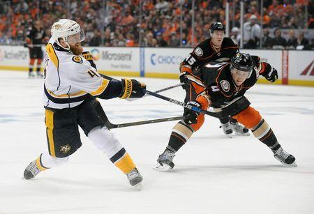 April 15, 2016; Anaheim, CA, USA; Nashville Predators defenseman Ryan Ellis (4) moves in for a shot on goal against Anaheim Ducks defenseman Cam Fowler (4) during the first period in game one of the first round of the 2016 Stanley Cup Playoffs at Honda Center. Mandatory Credit: Gary A. Vasquez-USA TODAY Sports