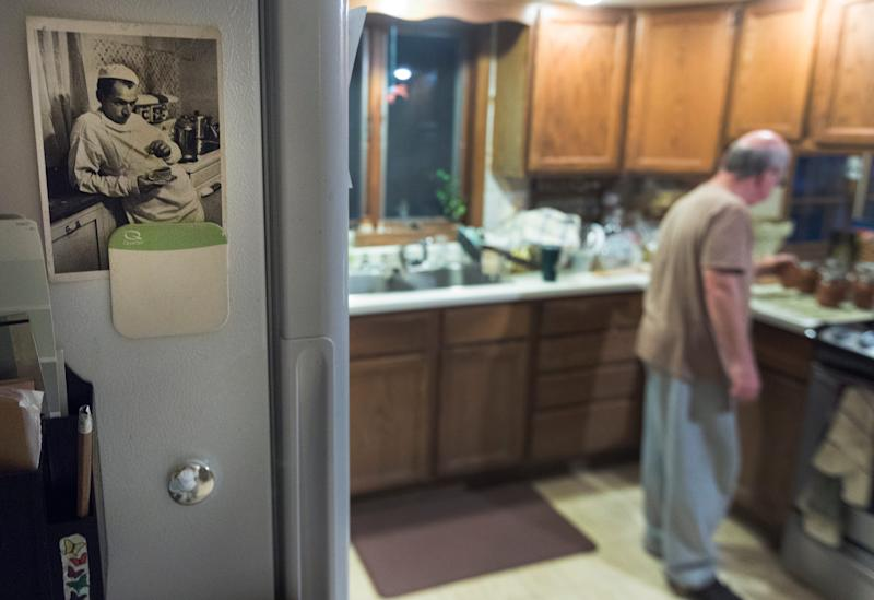 The photo of country doctor Ernest Guy Ceriani, made famous in a groundbreaking Life Magazine photo essay by W. Eugene Smith, hangs on James DeLine's refrigerator door at his home in La Farge.