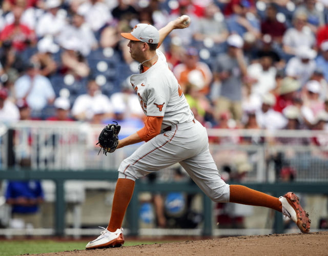 Texas pitcher Nolan Kingham throws against Arkansas in the first inning of an NCAA College World Series baseball game in Omaha, Neb., Sunday, June 17, 2018. (AP Photo/Nati Harnik)