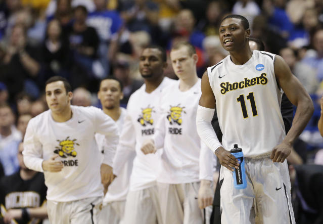 Wichita State forward Cleanthony Early (11) watches action against Cal Poly from the sideline during the second half of a second-round game in the NCAA college basketball tournament Friday, March 21, 2014, in St. Louis. (AP Photo/Charlie Riedel)