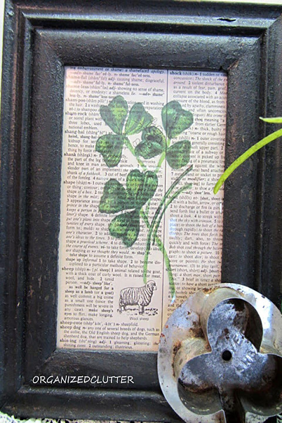 """<p>You can create this piece by printing a shamrock graphic onto old dictionary paper and placing it in a vintage-looking frame.</p><p><strong>Get the tutorial at <a href=""""http://www.organizedclutter.net/2013/02/luck-of-irish-vignette.html"""" rel=""""nofollow noopener"""" target=""""_blank"""" data-ylk=""""slk:Organized Clutter"""" class=""""link rapid-noclick-resp"""">Organized Clutter</a>. </strong></p>"""