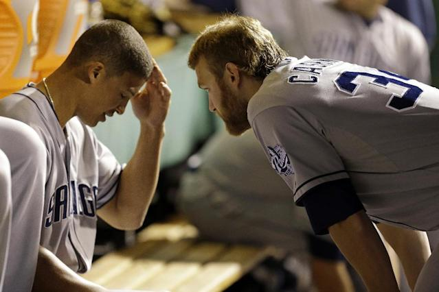 San Diego Padres starting pitcher Andrew Cashner, right, talks with teammate Will Venable in the dugout during the fourth inning of a baseball game against the Pittsburgh Pirates, Monday, Sept. 16, 2013, in Pittsburgh. (AP Photo/Gene J. Puskar)