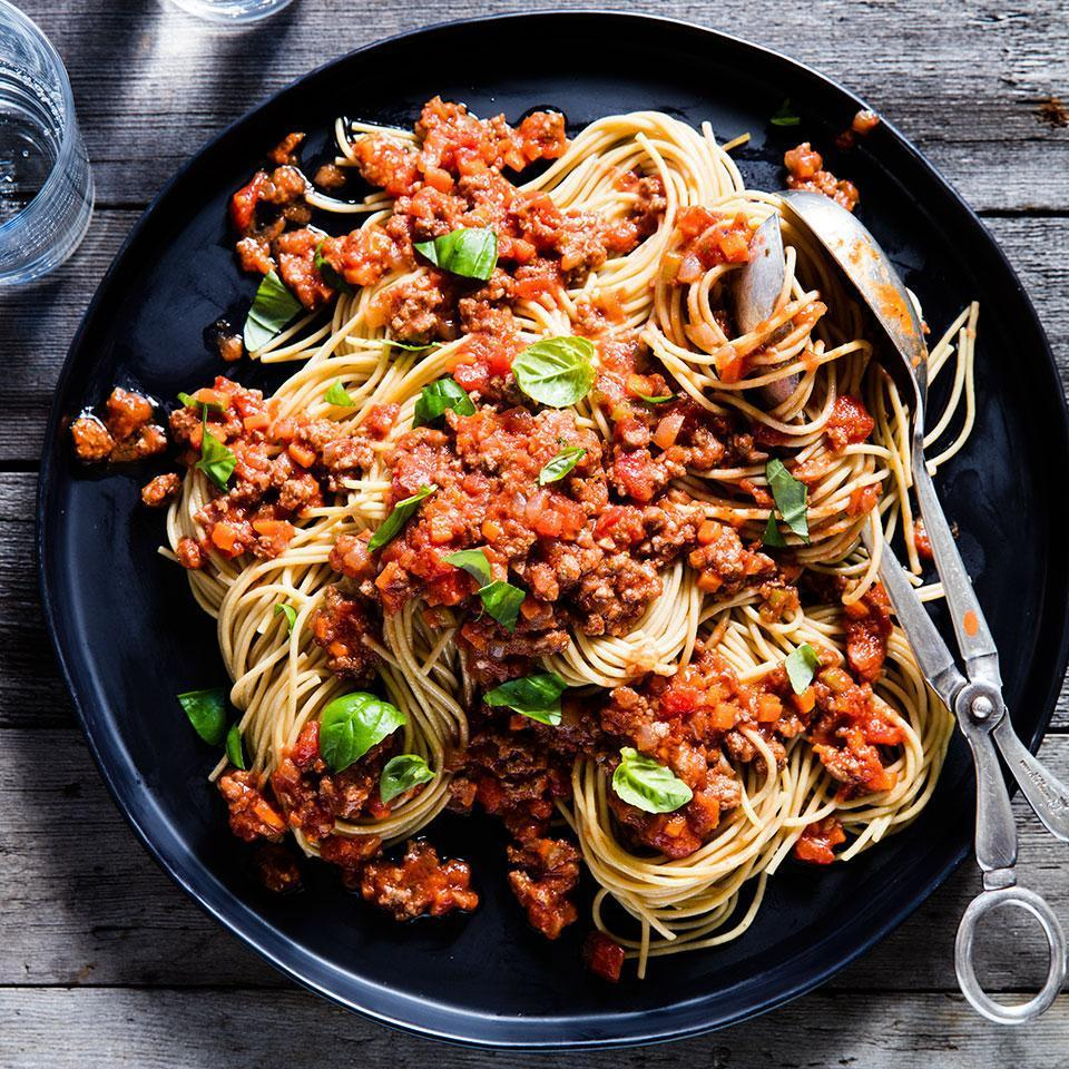"<p>Instead of opening a jar of sauce, try this easy spaghetti with meat sauce on a weeknight. Serve with steamed broccoli and garlic bread. The recipe makes enough for 8 servings. If you're serving only four for dinner, cook 8 ounces of spaghetti and freeze the leftover sauce. <a href=""http://www.eatingwell.com/recipe/250171/spaghetti-with-quick-meat-sauce/"" rel=""nofollow noopener"" target=""_blank"" data-ylk=""slk:View recipe"" class=""link rapid-noclick-resp""> View recipe </a></p>"