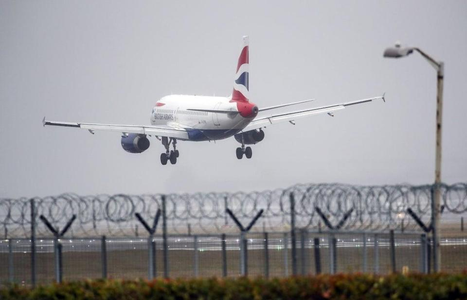A British Airways plane lands in the strong winds at Heathrow airport, (PA Archive)