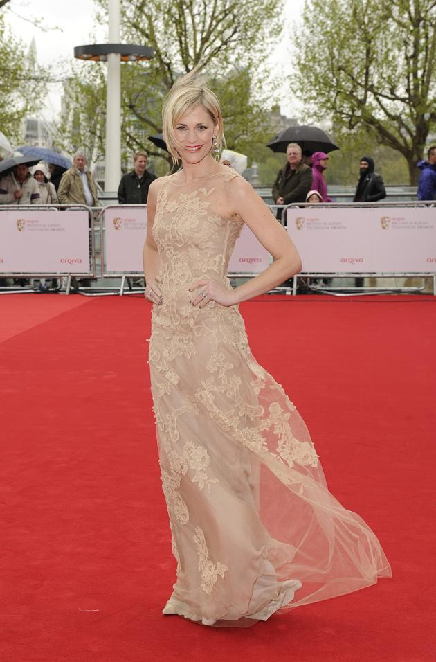 TV BAFTAS 2013 wardrobe malfunctions: Jenni Falconer had both her hair and her dress messed up by the wind. Copyright [Rex]