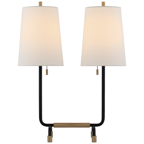 "<p><strong>Visual Comfort</strong></p><p>circalighting.com</p><p><strong>$529.00</strong></p><p><a href=""https://www.circalighting.com/adolfo-medium-desk-lamp-tob3732/"" rel=""nofollow noopener"" target=""_blank"" data-ylk=""slk:Shop Now"" class=""link rapid-noclick-resp"">Shop Now</a></p><p>This lamp pulls double duty for those late work-from-home nights.</p>"