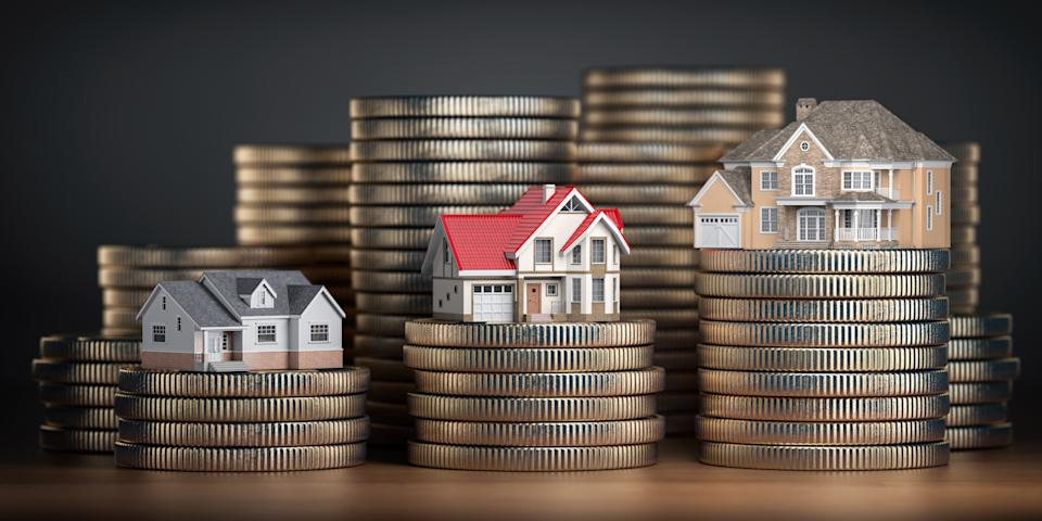 Houses of different size with different value on stacks of coins. Concept of  property, mortgage and real estate investment.  3d illustration