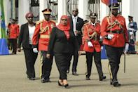 Hassan inspected a military guard of honour after being sworn in