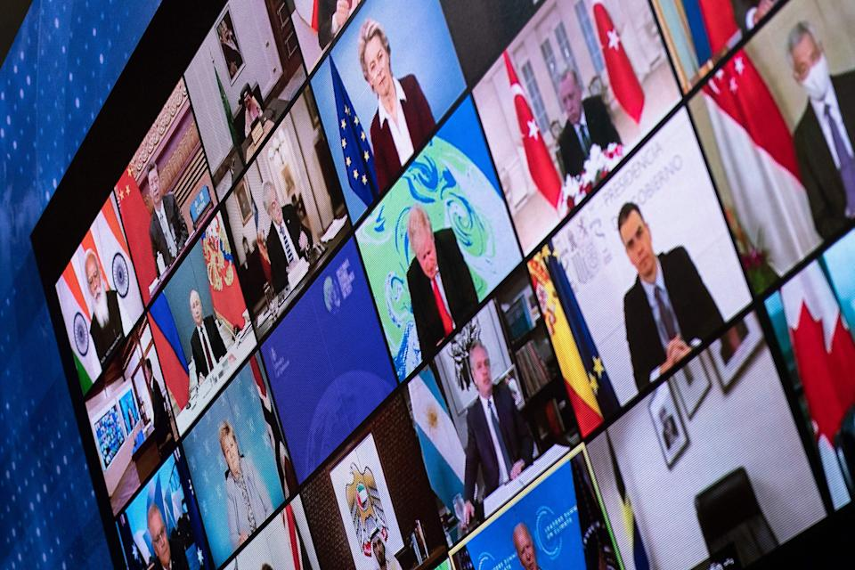 (From L-R)Russia's President Vladimir Putin, China's President Xi Jinping, Turkey's President Recep Tayyip Erdogan, United Kingdom's Prime Minister Boris Johnson, US President Joe Biden and others are seen on a screen during a climate change virtual summit from the East Room of the White House campus April 22, 2021, in Washington, DC. - US President Joe Biden on Thursday sharply ramped up US ambitions on slashing greenhouse gas emissions, leading new pledges by allies at a summit he hopes brings the world closer to limiting climate change. Putting the United States back at the forefront on climate, Biden told a virtual Earth Day summit that the world's largest economy will cut emissions blamed for climate change by 50 to 52 percent by 2030 compared with 2005 levels. (Photo by Brendan Smialowski / AFP) (Photo by BRENDAN SMIALOWSKI/AFP via Getty Images)