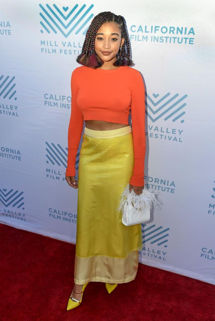 <p>Amandla Stenberg gave us major outfit inspiration this season in a neon crop top and saccharine sweet skirt for the premiere of 'The Hate You Give' on October 7. We need to find out where her feathered bag is from, asap. <em>[Photo: Getty]</em> </p>