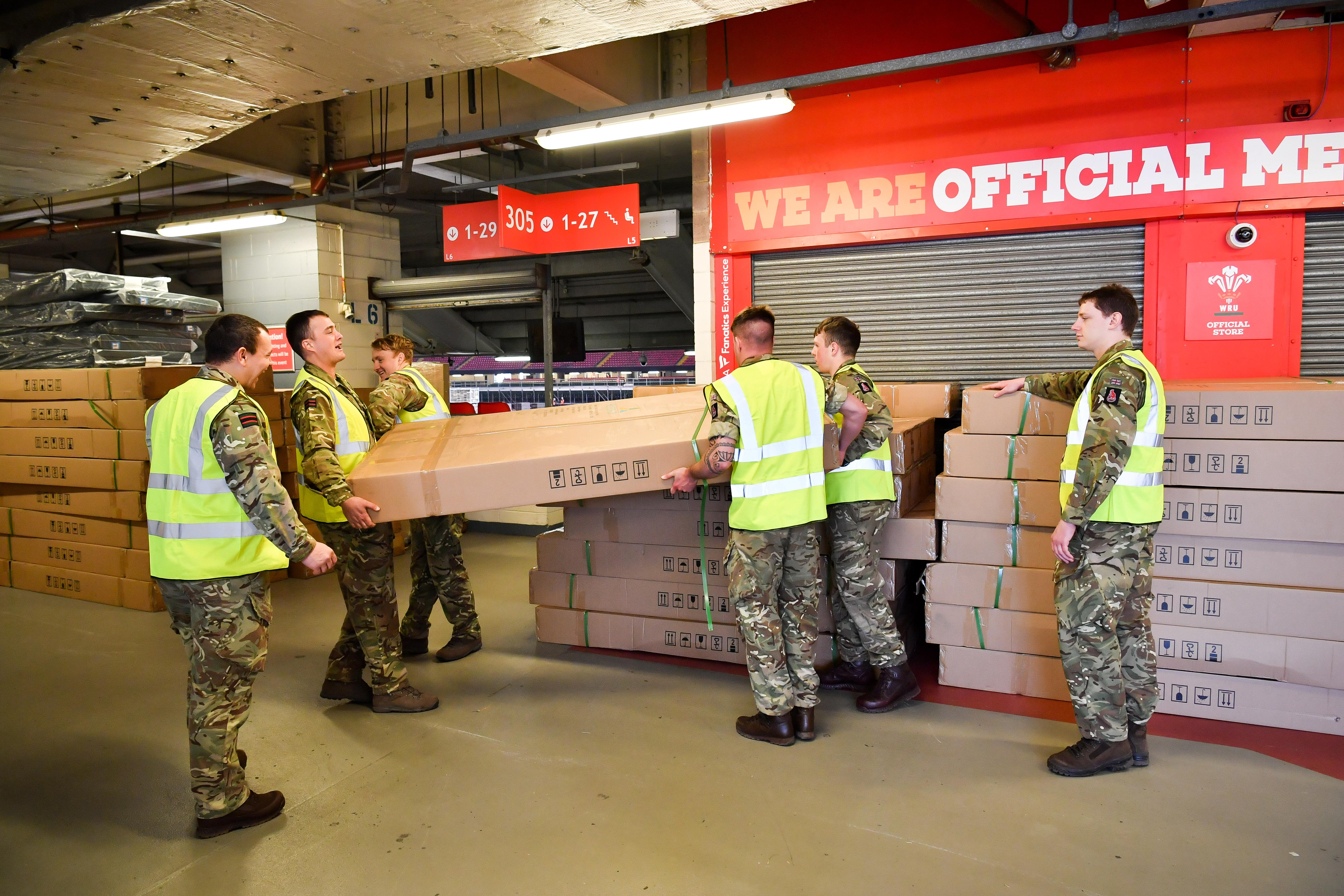 The British Army help move medical supplies at the Principality Stadium, Cardiff, which is being turned into a 2000-bed hospital to help fight coronavirus. (Photo by Ben Birchall/PA Images via Getty Images)
