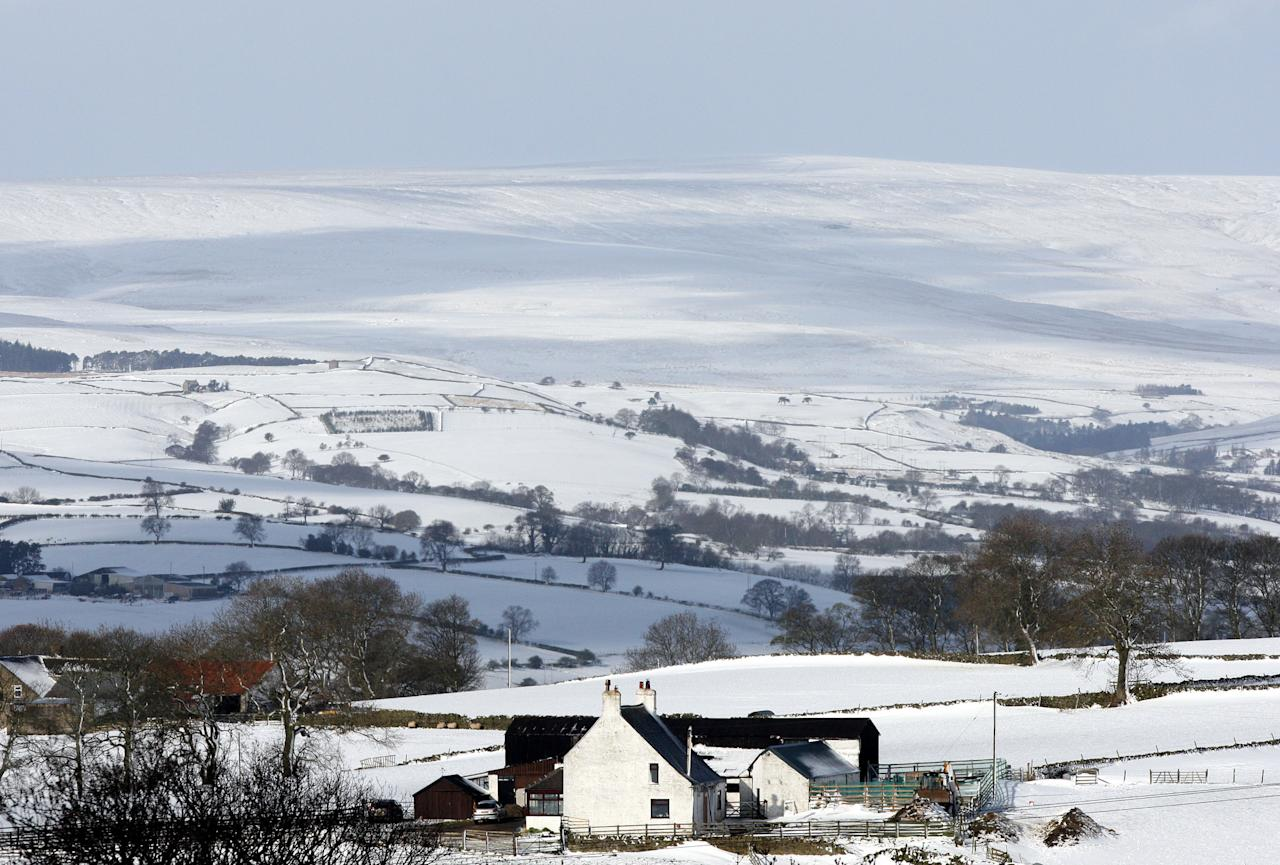 A farmhouse is seen surrounded by heavy snowfall at Tow Law, England, Wednesday, April 4, 2012. Parts of Scotland and northern England have received 20 centimeters (8 inches) of snow, and 10,000 homes are without power in northeast England after wind brought down power cables. (AP Photo/Scott Heppell)