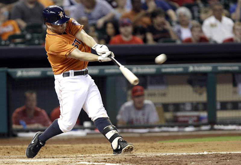 Houston Astros' Jose Altuve hits a three-run homer against the Los Angeles Angels in the third inning of a baseball game Friday, Sept. 13, 2013, in Houston. (AP Photo/Pat Sullivan)