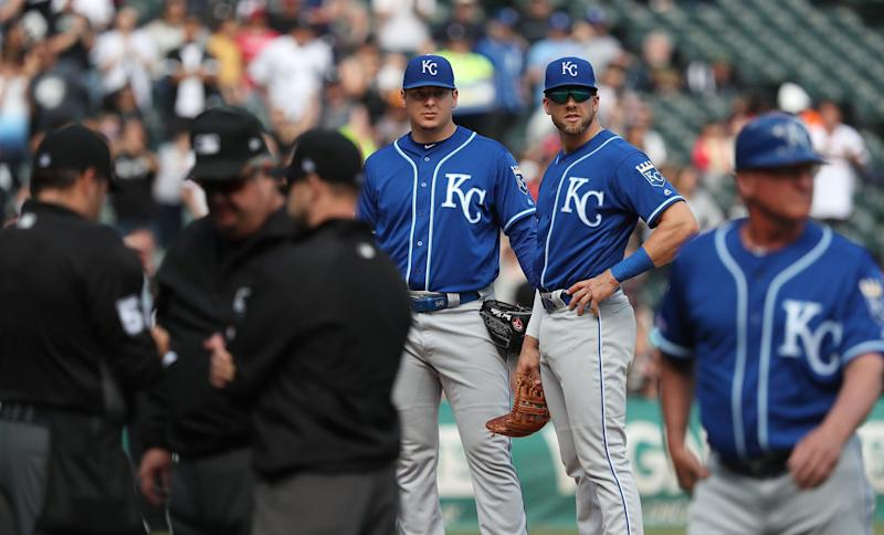 Royals pitcher Brad Keller, middle, kept up one of baseball's most ridiculous traditions last Wednesday. (John J. Kim/Chicago Tribune/TNS)