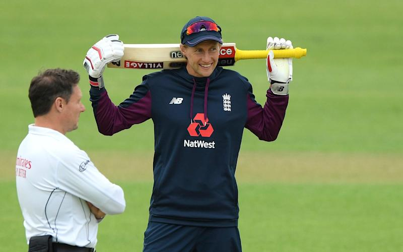 Joe Root talks to umpire Richard Kettleborough during day one of a warm-up match at the Ageas Bowl - AP