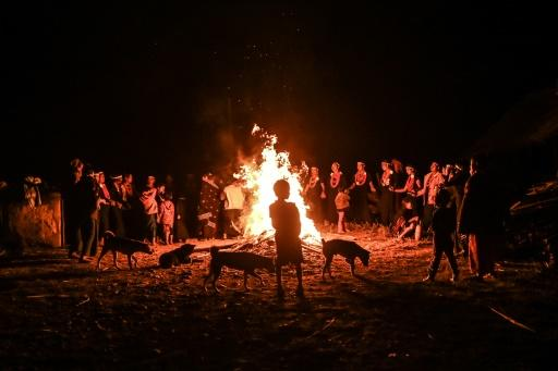 Dressed in black and wearing orange bead necklaces and palm leaf headbands, they rotate around a fire in Satpalaw Shaung village, hands held tightly and braving the cold with bare arms