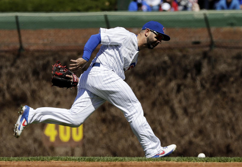 Chicago Cubs second baseman Daniel Descalso can't make the play on a single by Arizona Diamondbacks' Christian Walker during the first inning of a baseball game Saturday, April 20, 2019, in Chicago. (AP Photo/Nam Y. Huh)