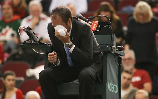 <p>FEBRUARY 5: Chair umpire Arnaud Gabas reacts to getting hit in the eye with a ball hit by Denis Shapovalov of Canada during the singles match between Kyle Edmund of Great Britain on day three of the Davis Cup World Group tie between Great Britain and Canada at TD Place Arena on February 5, 2017 in Ottawa, Ontario, Canada. (Photo by Andre Ringuette/Getty Images for LTA) </p>