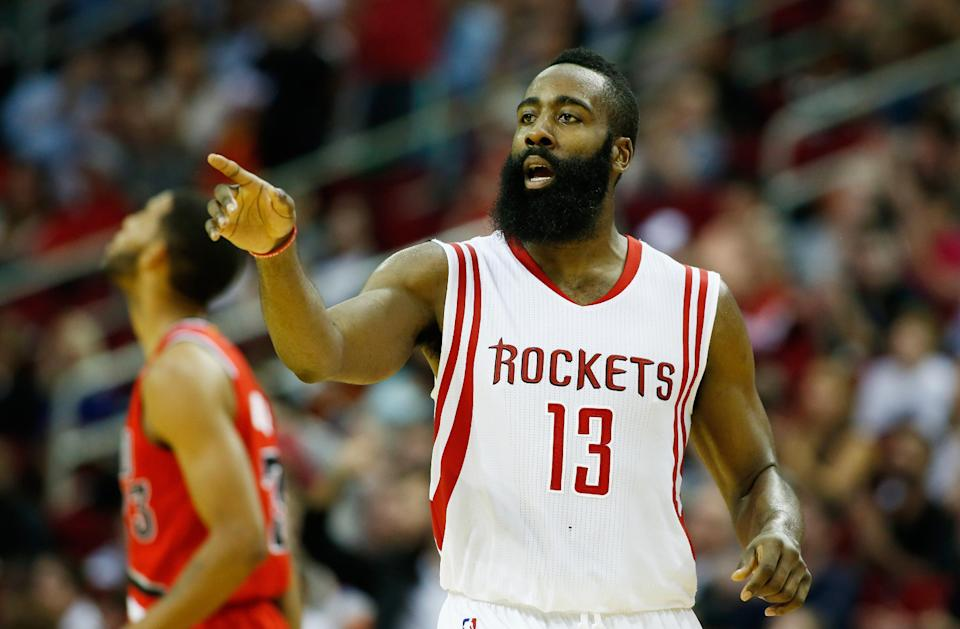 HOUSTON, TX - DECEMBER 22: James Harden #13 of the Houston Rockets reacts to a play on the court during their game against the Portland Trail Blazers at the Toyota Center on December 22, 2014 in Houston, Texas. (Photo by Scott Halleran/Getty Images)