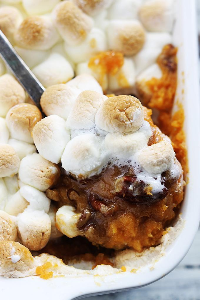 "<p>This casserole is the fluffy kind many people remember from their childhood, topped with marshmallows, brown sugar to candy the vegetables, and pecans on top of mashed sweet potatoes. The savory-mixed-with-sweet flavor give it more of a decadent dessert feel than that of a side dish. For those with limited oven or counter space, these sweet potatoes can be candied in advance in your slow cooker. <br><br><a href=""http://www.lecremedelacrumb.com/2016/11/candied-pecan-sweet-potato-casserole.html"" rel=""nofollow noopener"" target=""_blank"" data-ylk=""slk:Get the recipe"" class=""link rapid-noclick-resp"">Get the recipe</a> </p>"