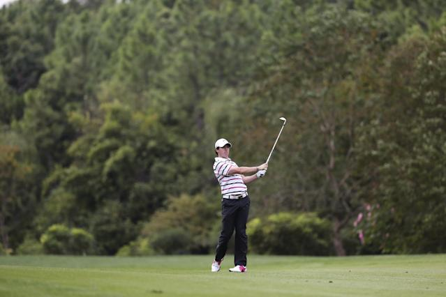 Rory Mcllory of Northern Ireland plays on the 8th fairway during the first round of the HSBC Champions golf tournament at the Sheshan International Golf Club in Shanghai, China, Thursday, Oct. 31, 2013. McIlroy looked more like a two-time major champion Thursday when he opened with a 7-under 65 to build a two-shot lead in HSBC Champions. McIlroy was at his best around the turn when he made four birdies in a five-hole stretch. (AP Photo/Eugene Hoshiko)