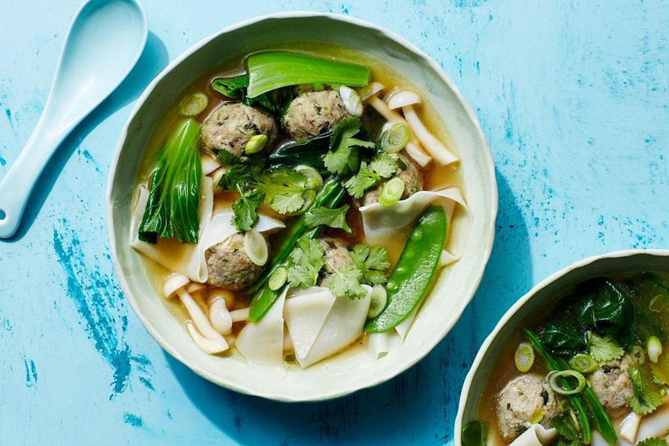 """Thanks to a zingy ginger, garlic, and miso paste mixture, these vitamin- and fiber-loaded mushroom and zucchini """"meatballs"""" are so packed with flavor you'll hardly realize they're missing the traditional meaty ingredient. Dropping the unstuffed wonton wrappers into the soup whole, instead of sealing the vegetables inside, keeps the recipe simple and weeknight-friendly. <a href=""""https://www.epicurious.com/recipes/food/views/wonton-soup-with-mushroom-zucchini-meatballs?mbid=synd_yahoo_rss"""" rel=""""nofollow noopener"""" target=""""_blank"""" data-ylk=""""slk:See recipe."""" class=""""link rapid-noclick-resp"""">See recipe.</a>"""
