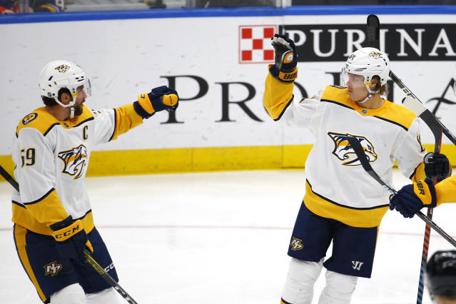 Nashville Predators' Mikael Granlund, right, of Finland, celebrates with Roman Josi, of Switzerland, after scoring the game winning goal against the St. Louis Blues during the third period of an NHL hockey game Saturday, Feb. 15, 2020, in St. Louis. (AP Photo/Billy Hurst)