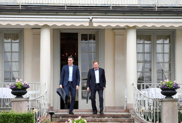 Spanish Prime Minister Pedro Sanchez and Sweden's Prime Minister Stefan Lofven walk during their meeting in Harpsund