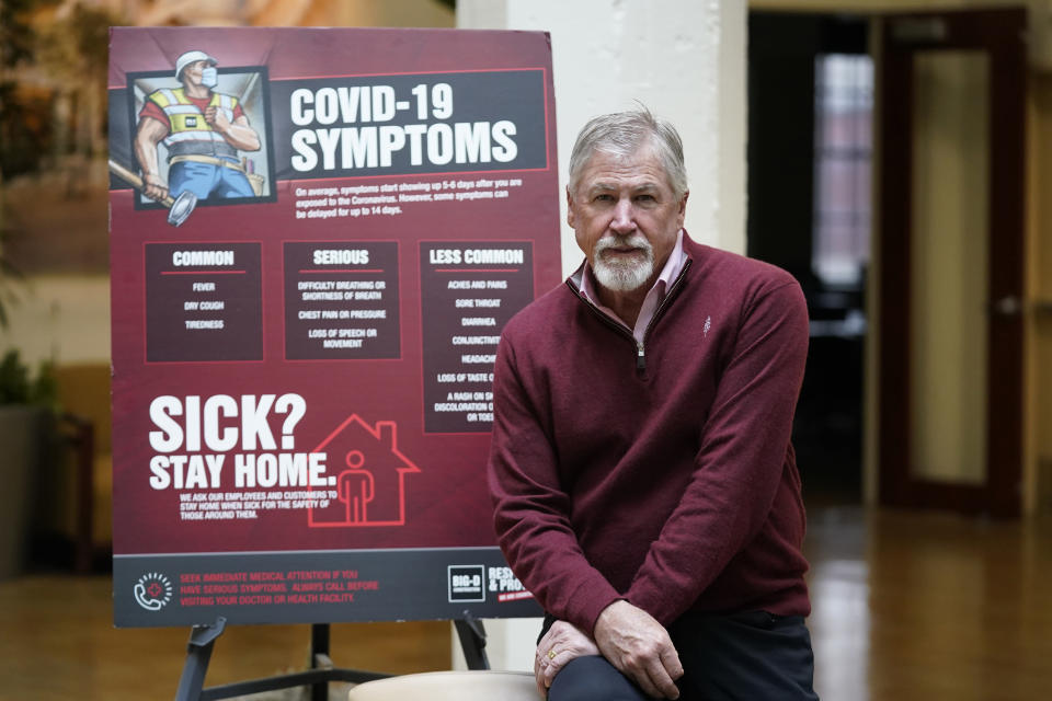 Rob Moore is the CEO of Salt Lake City-based Big-D Construction poses for a photograph Monday, Oct. 11, 2021, in Salt Lake City. Moore said he supports vaccines but has questions about the mandate rollout. He already has a worker shortage on his job sites, and he said employee surveys tell him that nearly 20% of his workers don't want to get inoculated, so they would need to be tested weekly. (AP Photo/Rick Bowmer)