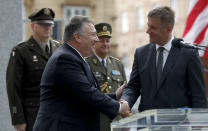 U.S. Secretary of State Mike Pompeo, front left, shakes hands with Czech Republic's Foreign Minister Tomas Petricek, right, during a ceremony at the General Patton memorial in Pilsen near Prague, Czech Republic, Tuesday, Aug. 11, 2020. U.S. Secretary of State Mike Pompeo is in Czech Republic at the start of a four-nation tour of Europe. Slovenia, Austria and Poland are the other stations of the trip. (AP Photo/Petr David Josek, Pool)