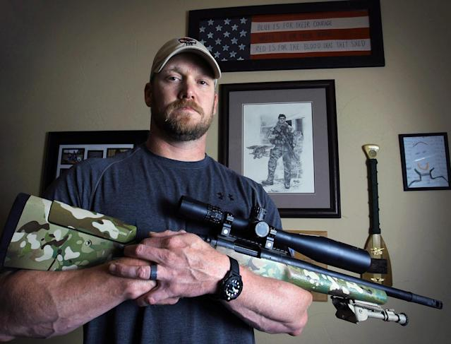 """FILE - In this April 6, 2012 file photo, Chris Kyle, a former Navy SEAL and author of the book """"American Sniper,"""" poses in Midlothian, Texas. Kyle and his friend Chad Littlefield were fatally shot at a shooting range southwest of Fort Worth, Texas, on Saturday, Feb. 2, 2013. Former Marine Eddie Ray Routh, who came with them to the range, has been arrested for the murders. (AP Photo/The Fort Worth Star-Telegram, Paul Moseley, File)"""
