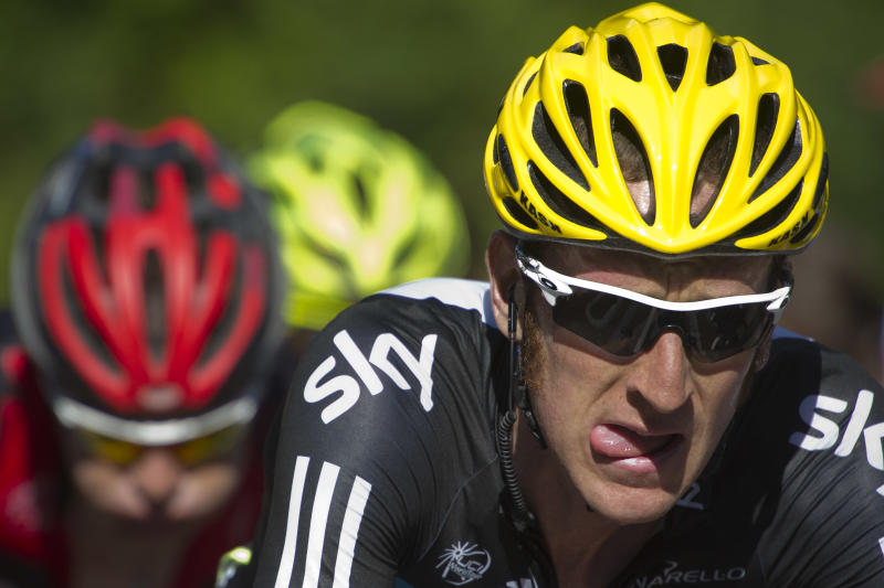 New overall leader Bradley Wiggins of Britain, right, grimaces in the last climb towards La Planche des Belles Filles, as he rides with Cadel Evans of Australia, left, during the seventh stage of the Tour de France cycling race over 199 kilometers (123.6 miles) with start in Tomblaine and finish in La Planche des Belles Filles, France, Saturday July 7, 2012. (AP Photo/Lionel Bonaventure, Pool)