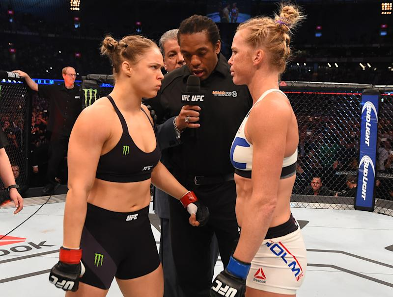 MELBOURNE, AUSTRALIA - NOVEMBER 15: (L-R) Opponents UFC women's bantamweight champion Ronda Rousey of the United States and Holly Holm of the United States face off before their UFC women's bantamweight championship bout during the UFC 193 event at Etihad Stadium on November 15, 2015 in Melbourne, Australia. (Photo by Josh Hedges/Zuffa LLC/Zuffa LLC via Getty Images)