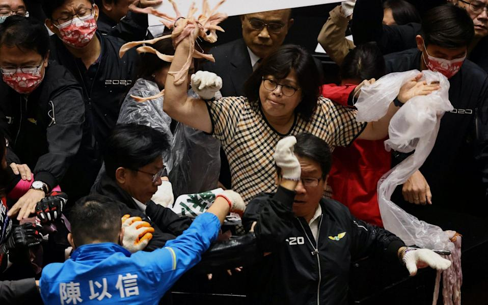 Taiwan lawmakers throw pork intestines at each other during a scuffle in the parliament in Taipei, Taiwan - REUTERS