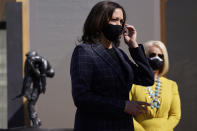 Vice presidential candidate Sen. Kamala Harris, D-Calif., and Cindy McCain listen as they visit the American Indian Veterans National Memorial with tribal leaders and veterans at Heard Museum in Phoenix, Thursday, Oct. 8, 2020. (AP Photo/Carolyn Kaster)