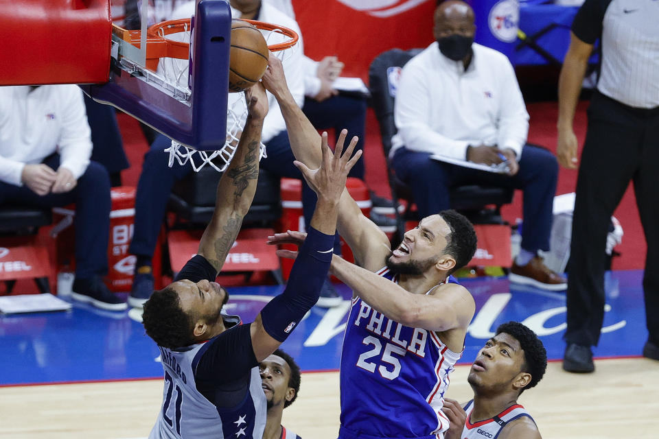 Daniel Gafford #21 of the Washington Wizards and Ben Simmons #25 of the Philadelphia 76ers reach for a rebound during the first quarter during Game Five of the Eastern Conference first round series at Wells Fargo Center on June 2, 2021 in Philadelphia, Pennsylvania. NOTE TO USER: User expressly acknowledges and agrees that, by downloading and or using this photograph, User is consenting to the terms and conditions of the Getty Images License Agreement. (Photo by Tim Nwachukwu/Getty Images)