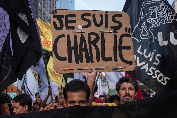 "A demonstrator holds a placard reading ""Je Suis Charlie"" (I am Charlie) -- a slogan that has come to symbolise the fight for freedom of expression after jihadist gunmen stormed the Paris offices of satirical magazine Charlie Hebdo (AFP Photo/Yasuyoshi Chiba )"