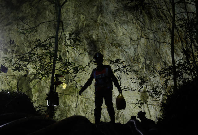 <p>A rescuer makes his way down to the entrance to a cave complex where it's believed that 12 soccer team members and their coach went missing, in Mae Sai, Chiang Rai province, in northern Thailand, July 1, 2018. (Photo: Sakchai Lalit/AP) </p>