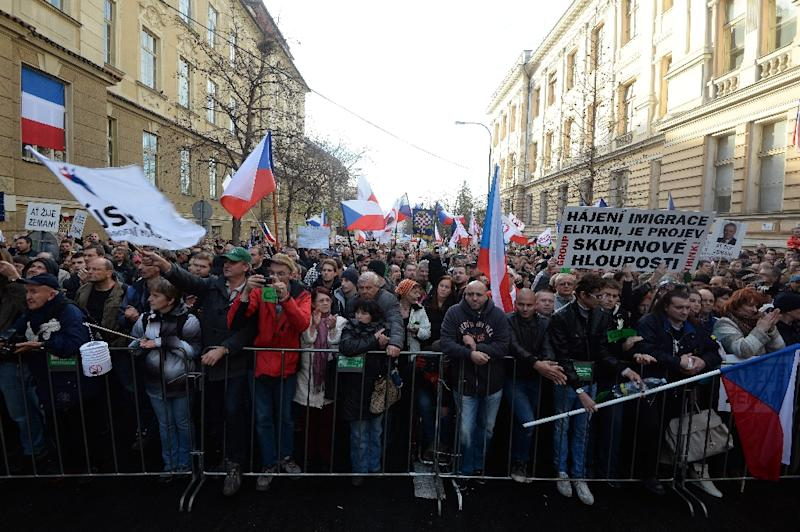 People holding Czech national flags attend an anti-Islam rally and support Czech President Milos Zeman on the 26th anniversary of the Velvet Revolution on November 17, 2015 in Prague