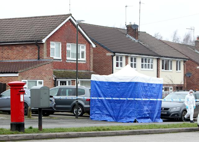 Police forensic officers at the scene where a tent has been erected outside the scene on New Zealand Lane, Duffield (SWNS)