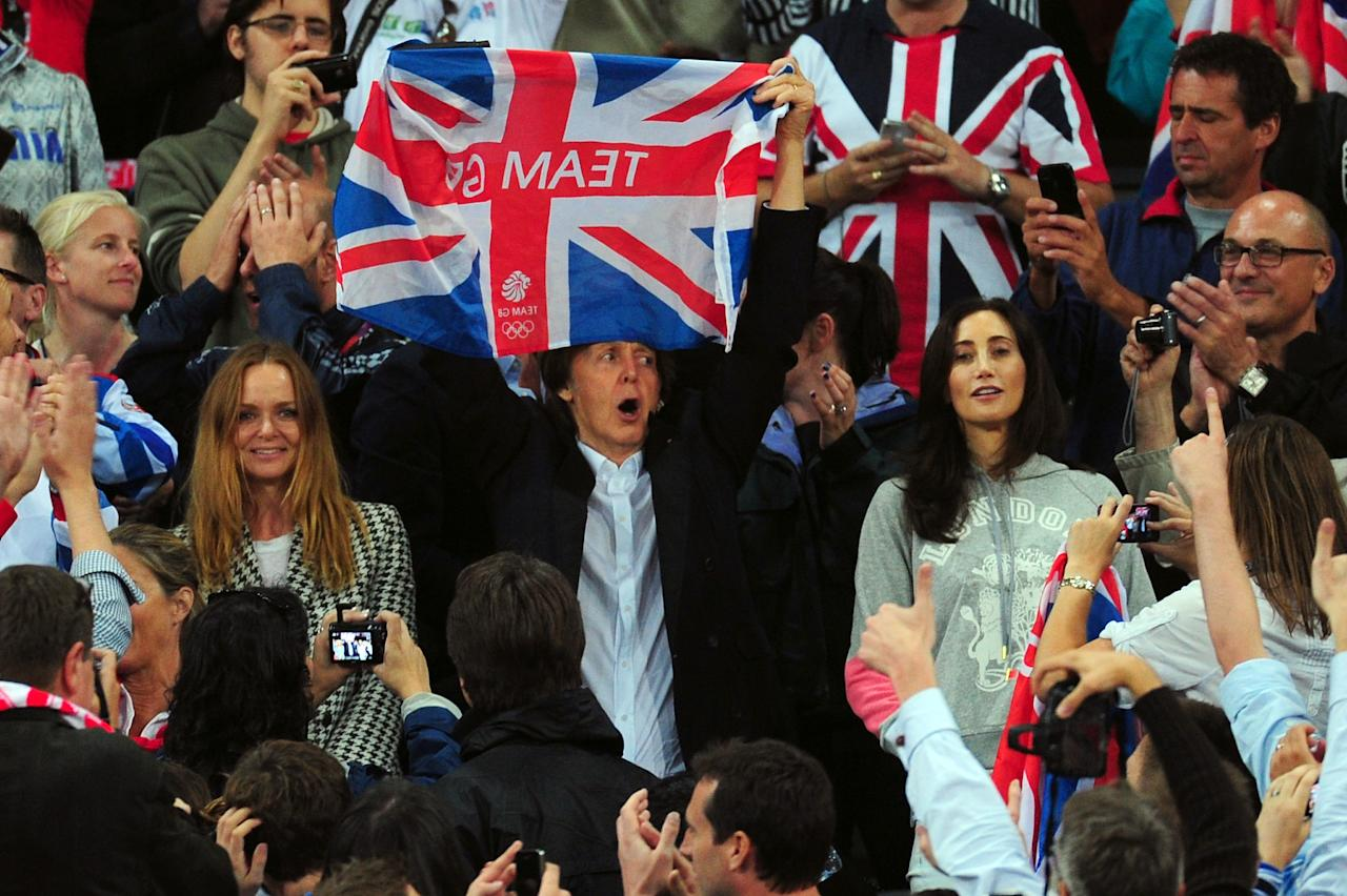 LONDON, ENGLAND - AUGUST 04: (L-R) Designer Stella McCartney, Paul McCartney and wife Nancy Shevell cheer on the athletes on Day 8 of the London 2012 Olympic Games at Olympic Stadium on August 4, 2012 in London, England.  (Photo by Stu Forster/Getty Images)