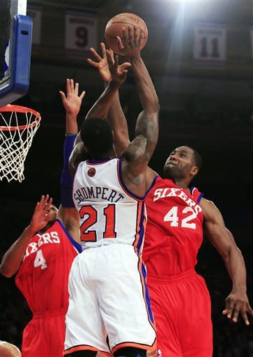Philadelphia 76ers' Elton Brand (42) blocks a shot by New York Knicks' Iman Shumpert (21) during the first half of an NBA basketball game, Wednesday, Jan. 11, 2012, in New York. (AP Photo/Frank Franklin II)