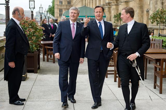 Prime Minister David Cameron talks with his Canadian counterpart Stephen Harper ahead of Mr Harper's address to the House of Commons in central London.