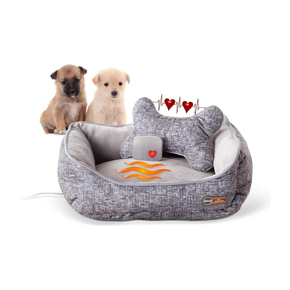 """The holidays are about treating <em>every</em> family member, furry friends included. This adorable animal bed comes with a heated cushion and pulsating device to mimic the warmth and heartbeat of mother dogs and cats, so younglings can sleep soundly. $60, Amazon. <a href=""""https://www.amazon.com/PET-PRODUCTS-Mothers-Heartbeat-Heated/dp/B08BH1LHBD/ref=sr_1_1?"""" rel=""""nofollow noopener"""" target=""""_blank"""" data-ylk=""""slk:Get it now!"""" class=""""link rapid-noclick-resp"""">Get it now!</a>"""