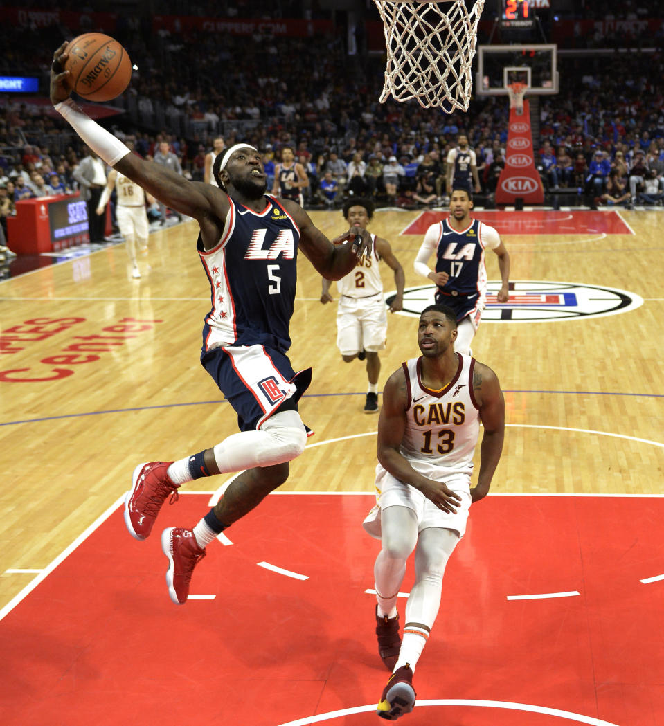 LOS ANGELES, CA - MARCH 30: Montrezl Harrell #5 of the Los Angeles Clippers scores a basket against Tristan Thompson #13 of the Cleveland Cavaliers during the second half at Staples Center on March 30, 2019 in Los Angeles, California. (Photo by Kevork Djansezian/Getty Images)