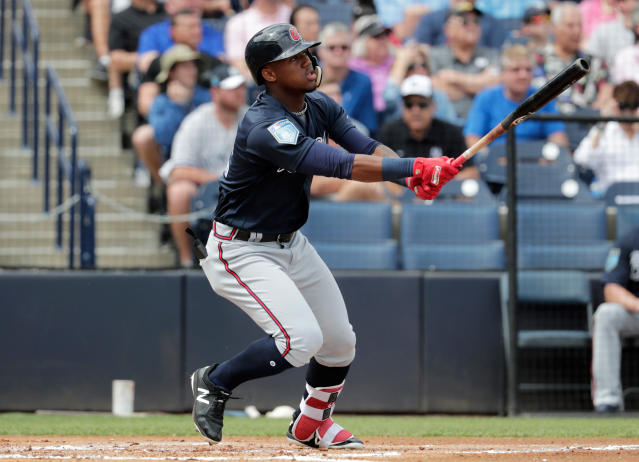 FILE - In this Friday, March 2, 2018, file photo, Atlanta Braves' Ronald Acuna watches after hitting a two-run home run during the first inning of a baseball spring exhibition game against the New York Yankees, in Tampa, Fla. Top outfield prospect Acuna is set to join the Atlanta Braves, who said they planned to promote the 20-year-old from Triple-A Gwinnett on Wednesday, April 25, 2018, to join them in Cincinnati. (AP Photo/Lynne Sladky, File)