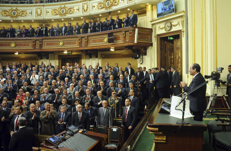 FILE - In this Feb. 13, 2016 file photo provided by Egypt's state news agency MENA, Egyptian President Abdel-Fattah el-Sissi, addresses parliament in Cairo, Egypt.  On Monday Feb. 10, 2020, the state-run news agency said Egypt's legislature gave its initial approval for toughening up already draconian anti-terrorism laws, with amendments that include life sentences and capital punishment for funding terrorism. (MENA via AP, File)