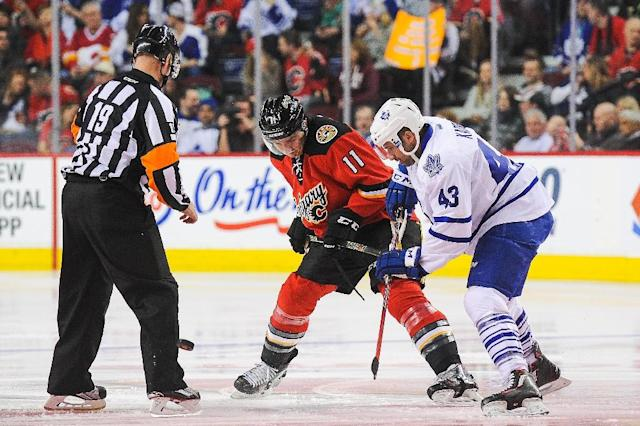 The Toronto Maple Leafs (blue) and Calgary Flames (red) are amoung five of the Canadian teams seeking redemption in this year's Stanley Cup playoffs after the 2016 drought that saw no Canadian clubs in contention for the Cup (AFP Photo/Derek Leung)