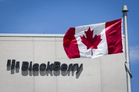 A Canadian flag is pictured in front of a Blackberry sign in Waterloo June 19, 2014. REUTERS/Mark Blinch/Files